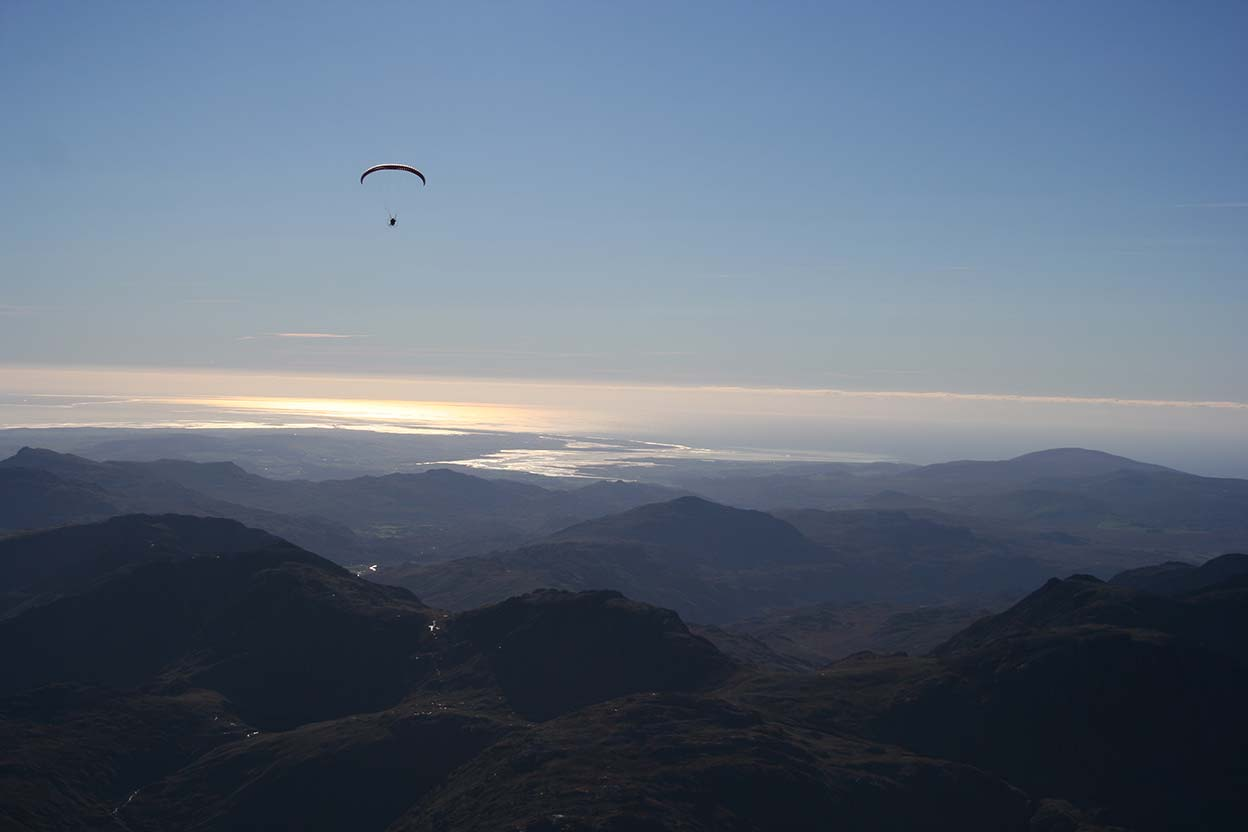 Looking into the sun above Glaramara towards the Duddon Estuary